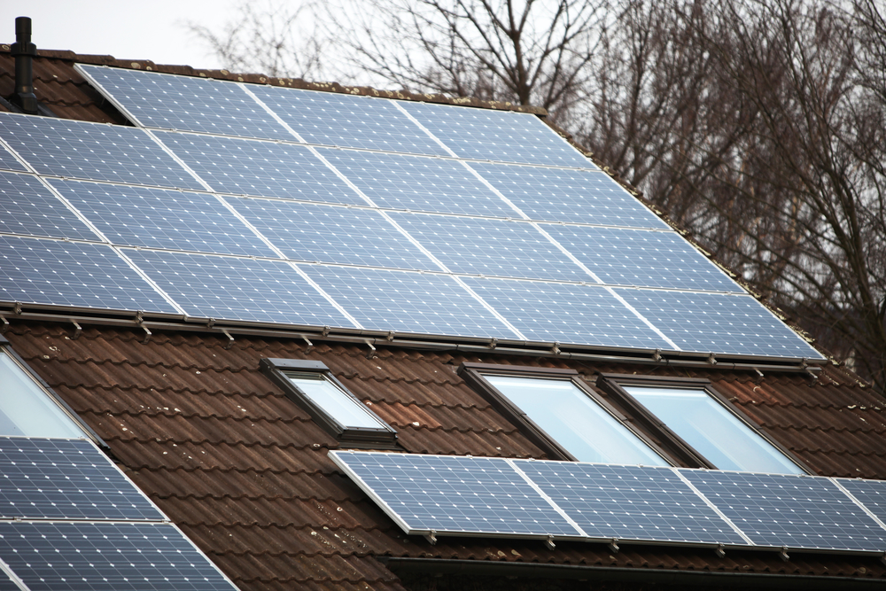 Solar panels on a house with roof windows