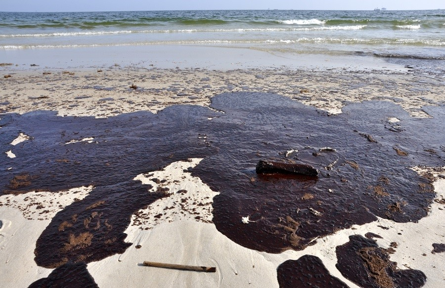 spots caused by oil spills on a beach
