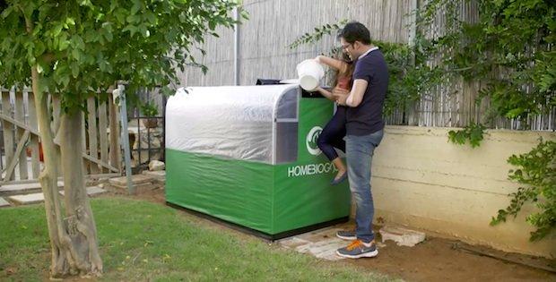 family feeding the home biogas system