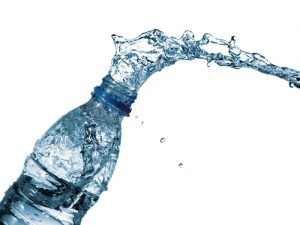 water splashing out of water bottle