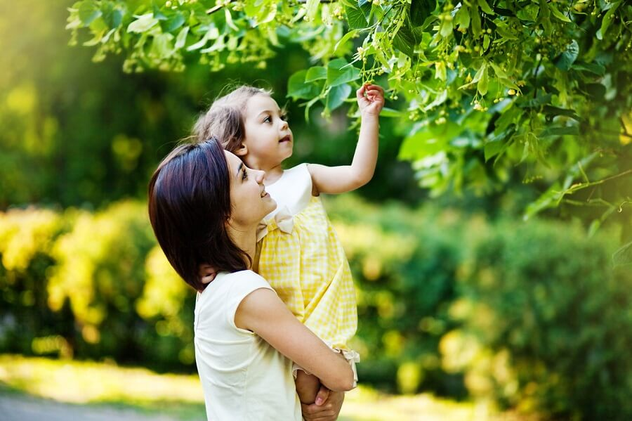 woman with child in her arms in nature