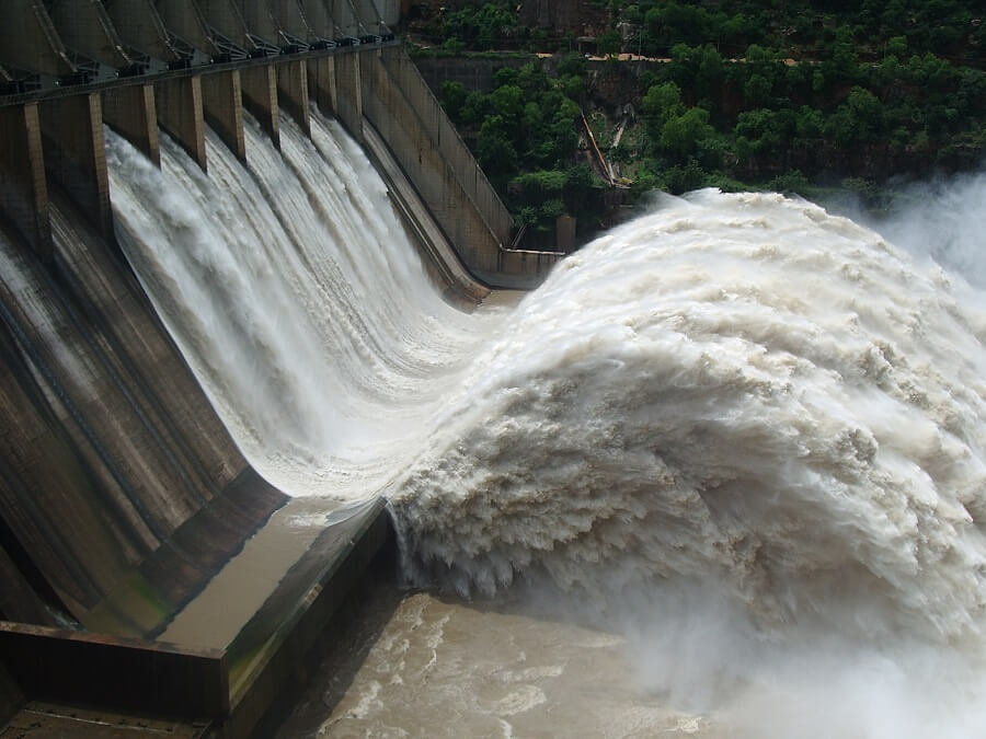 water coming out of a hydroelectric dam