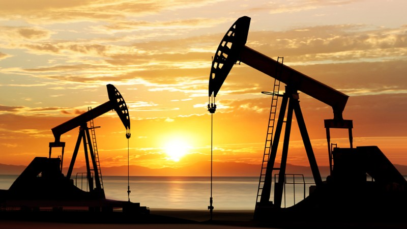 oil pumps shot at sunset